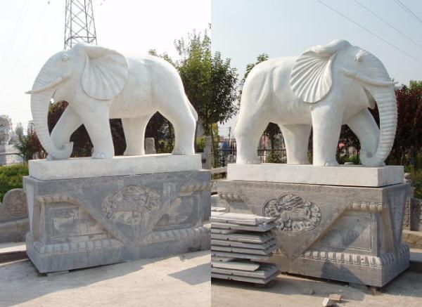动物石雕_游鲤塑像(图片)